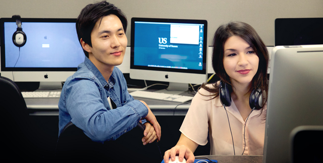Two international students in a computer lab